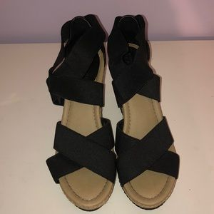 Black ankle wrap and cork wedges
